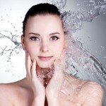 Beautiful woman water splash